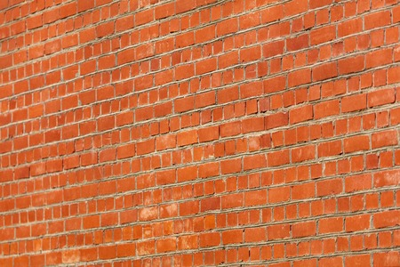 Cobbles of red brick as an abstract background .