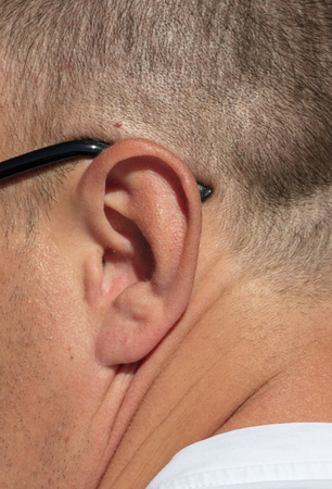 Ear on the head of a man .