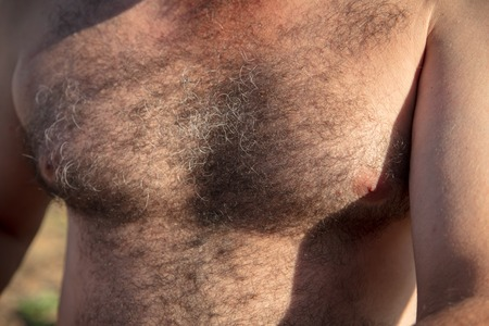 The hair grows on the chest of a man as a background .