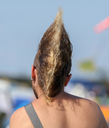 Hairstyle on the head of a punk man . Stock Photo