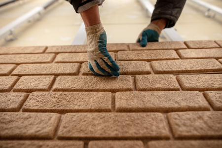 Installing siding on the wall of the house under the brick . Stock Photo - 112089351