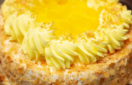 Cake with yellow cream and pineapple. Macro
