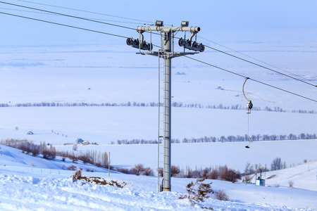 Ski lift and snowboarders in the mountains 写真素材 - 118823729