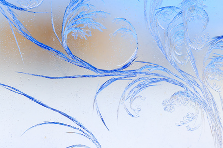 Snow patterns on glass as an abstract background . Stock Photo