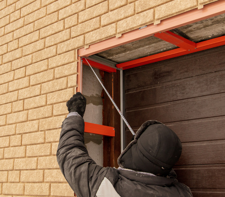 Installation of the gate in the garage metal .