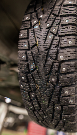 Winter tires on wheels in the workshop . Stockfoto