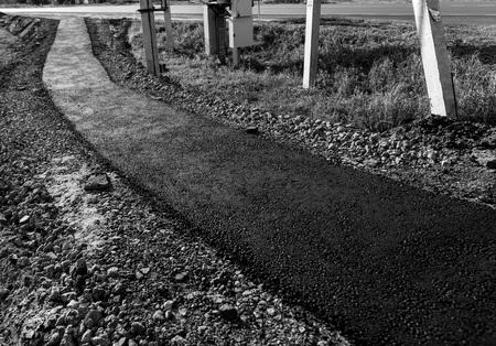 New asphalt on a pedestrian road as a background. Stockfoto