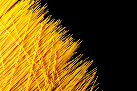 Pasta from dough as an abstract background . Reklamní fotografie