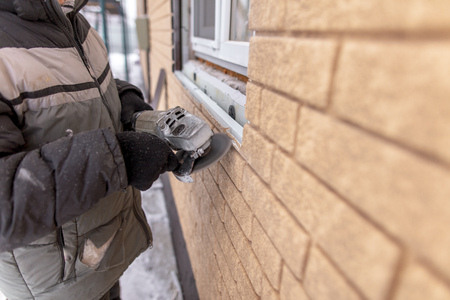 Installing brick siding on the wall of the house . Stock Photo - 119397237