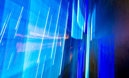 Blue light indoors in motion as abstract background. Banco de Imagens