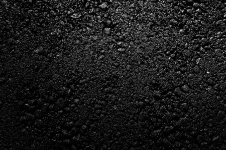 New asphalt road as background. Abstract texture