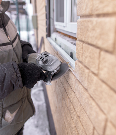 Installing brick siding on the wall of the house . Stock Photo - 119727255