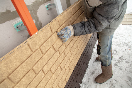 Installing brick siding on the wall of the house . Stock Photo - 120085854