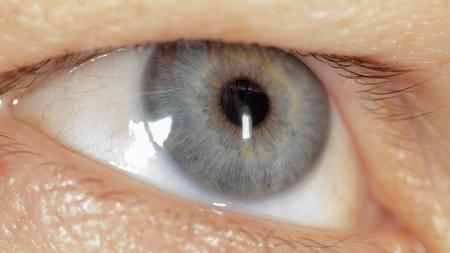 Blue eye on the man's face. Macro. Archivio Fotografico - 121326223