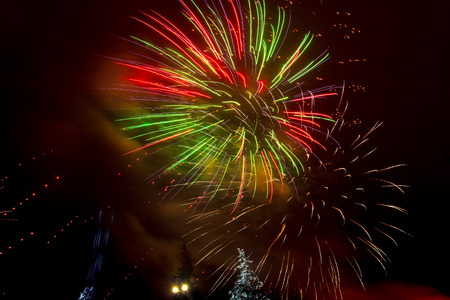 Beautiful sparks from fireworks in the sky at night.