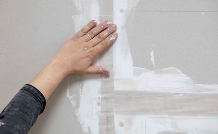 Tape for plaster on the wall. Repair in the house. Stock Photo
