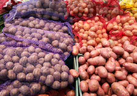 Potatoes on the counter in the store .