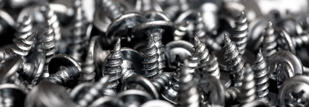 Sharp screws as abstract background. Stock Photo