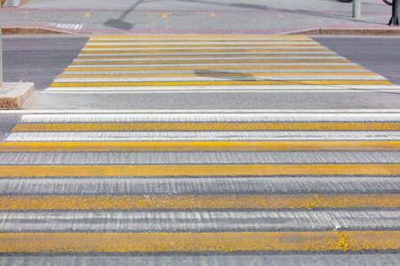 Pedestrian crossing painted on asphalt in the city