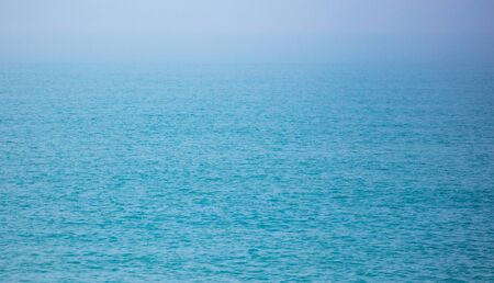 Expanse of water on the sea with a foggy horizon .