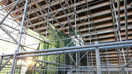 Metal scaffolding under the podium of the stadium .