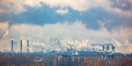 The smoke from the pipes of the metallurgical plant pollutes the environment