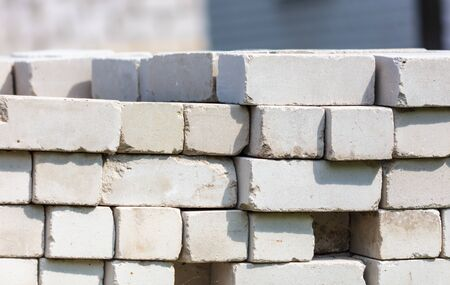 White bricks lay on a house construction site.