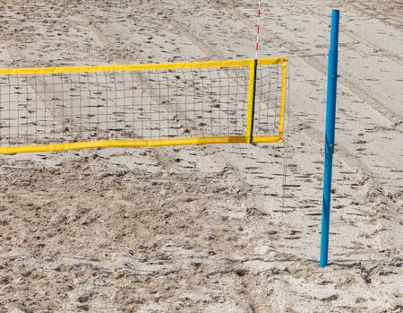 Beach volleyball net with sand .