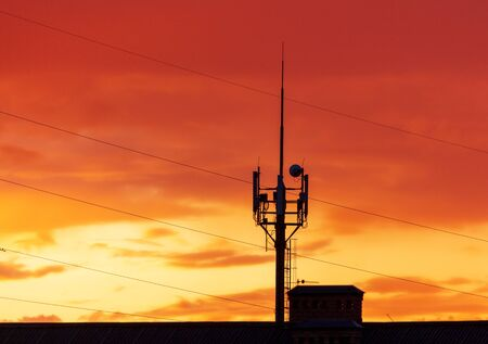 Antenna for cell phones at sunset.