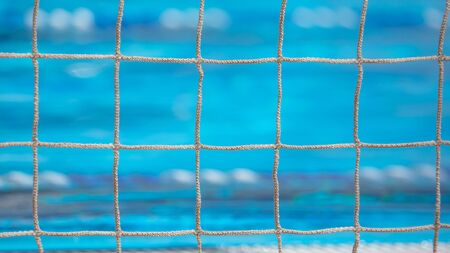 Grid over the pool water. Water polo Imagens