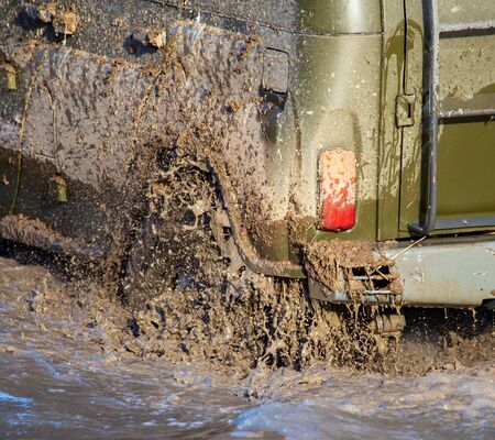SUV wheel stalled in mud and water. Stock Photo