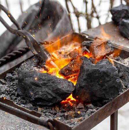 Burning black coal at the blacksmith.