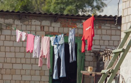 Laundry washed on a rope in the yard.