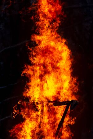 Flame of fire from a burning house as an abstract background.