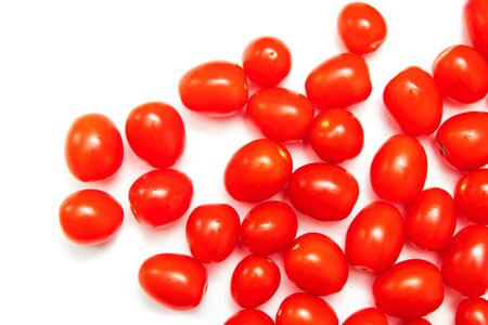 Red cherry tomatoes on a white background. 写真素材