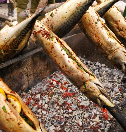 Mackerel meat is fried on charcoal in nature. Stok Fotoğraf - 129857977