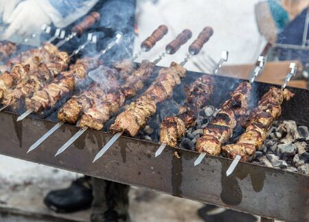 Barbecue skewers grilled on charcoal. Stock Photo - 129858221