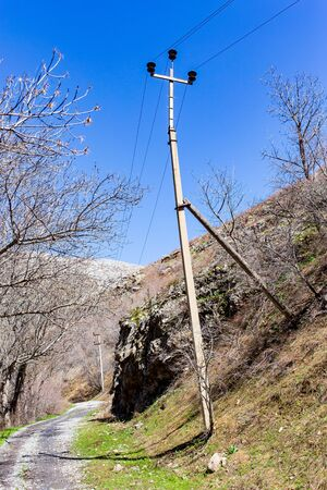 Electric post in the mountains. Stok Fotoğraf