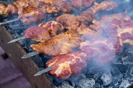 Barbecue skewers grilled on charcoal. Stock Photo