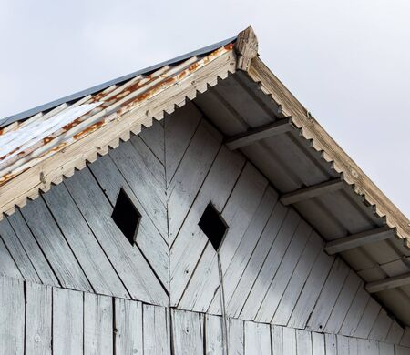 Wooden visor on the roof of the house. Stock Photo