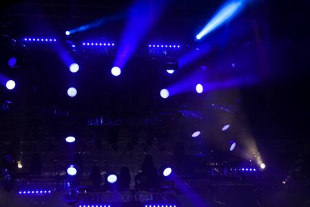 Blue light on a rock concert stage as background.