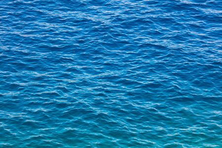 Blue expanse of water at sea as abstract background.