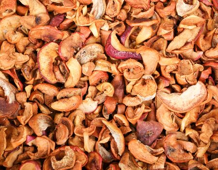Dried apples on the counter in the market.