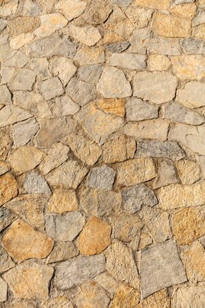 Wall of stone blocks as an abstract background. Stock fotó