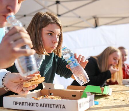 Lipetsk, Russia - September 21, 2019: Gastronomic festival. Pizza eating contest in the park. Éditoriale