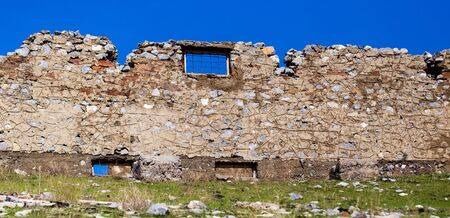 The ruins of an old abandoned house.