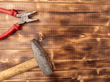 Hammer and torches on a wooden background.