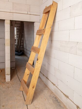 A wooden staircase at a construction site. Stock Photo