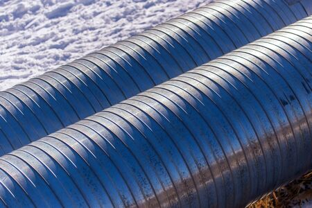 Large pipes in the snow in winter.