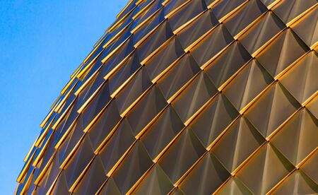 Gold plating on the dome against the sky.